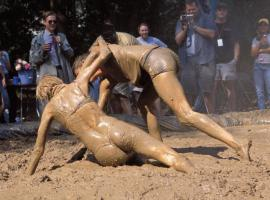 Man and women mud wrestling