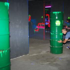 Men hiding during laser quest